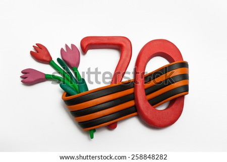 Crafts out of clay. The number seventy, flower, and St. George ribbon.. - stock photo