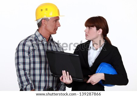 craftsman and businesswoman having a discussion