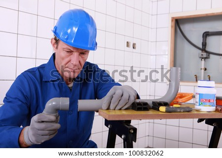 craftsman assembling pipes