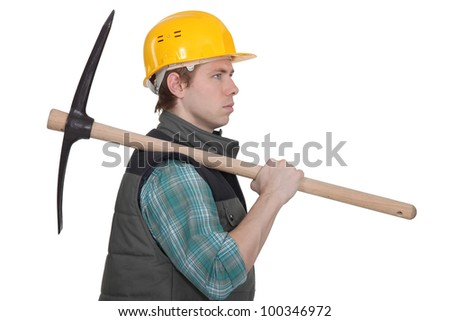 craftsman carrying a pick on his shoulder