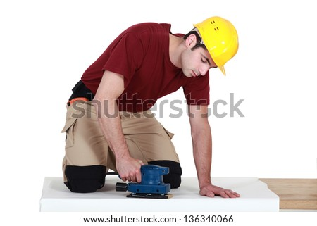 craftsman covering a board - stock photo