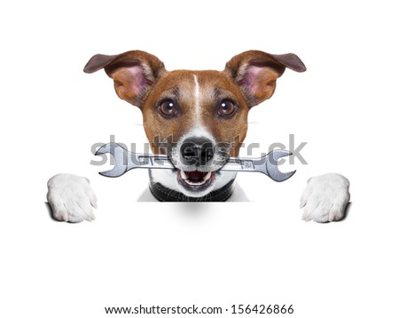 craftsman dog behind a blank banner with work tool - stock photo