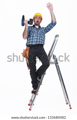 craftsman falling off a ladder - stock photo
