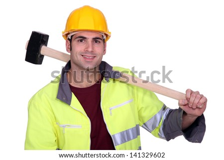 craftsman holding a huge hammer on his shoulder