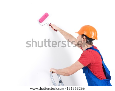 Craftsman painter stands on the stairs with roller,  portrait over white background , rear view - stock photo
