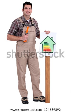 craftsman putting an energy consumption label - stock photo