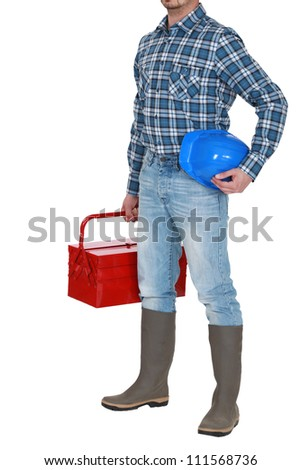 craftsman standing with toolbox and safety helmet - stock photo