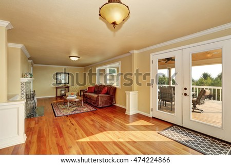 Craftsman-style family room   with hardwood floor, beige walls and persian red rug. Northwest, USA