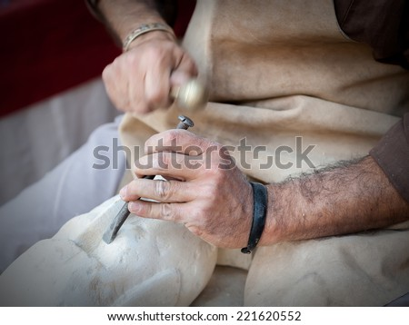 craftsman working on stone isolated on hands - stock photo