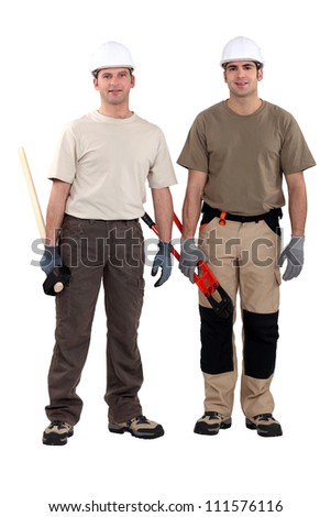 craftsmen posing together - stock photo