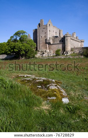 Craigmillar Castle in Edinburgh, Scotland, was founded circa 1400 by the Preston family and has strong historical connections with Mary Queen of Scots who was a frequent visitor. - stock photo