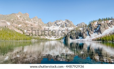 Cramer Lake reflection, in the Sawtooth National Recreation Area, near Stanley, Idaho. - stock photo