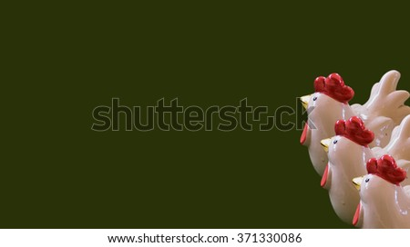 cramic Chicken with green background,ceramic,old Ceramic, Ceramic Chicken,Decorative ceramic, Chicken with colorful ceramic shape,beautiful ceramic of thailand,doll on the floor - stock photo