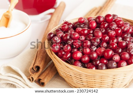 Cranberries in the basket on the table  - stock photo