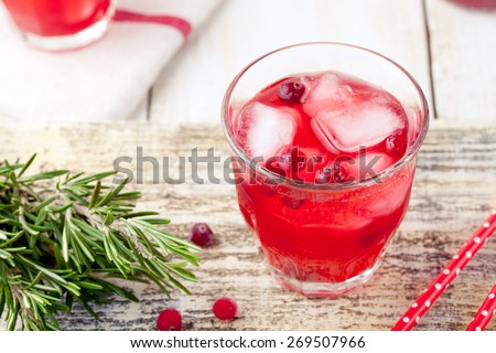 Cranberry and rosemary lemonade, cocktail, fizz on a white wooden background - stock photo