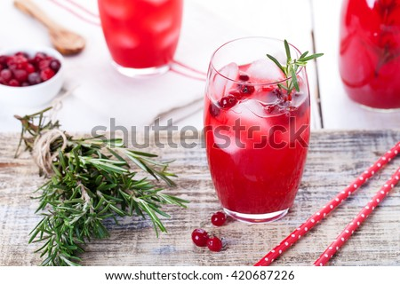 Cranberry and rosemary lemonade, cocktail, fizz on a wooden background - stock photo