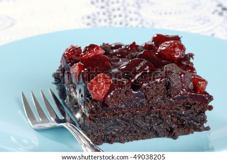 cranberry brownie with a fork - stock photo