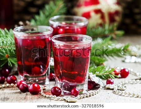 Cranberry drink on Christmas background, selective focus - stock photo