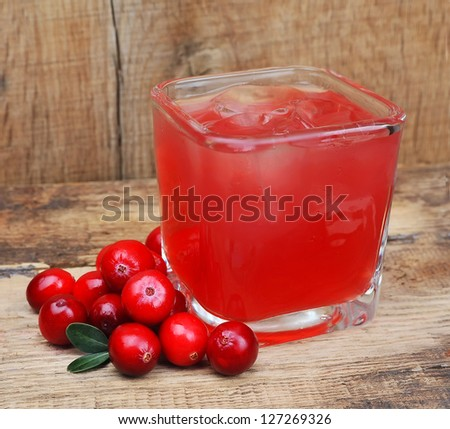 Cranberry drink on wooden table. Berry cocktail - stock photo