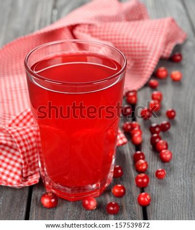 cranberry juice a glass on gray background - stock photo