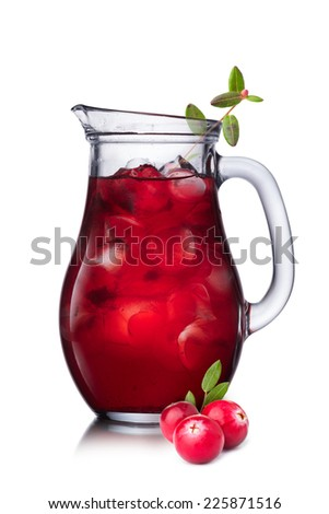 Cranberry juice in pitcher. Russian mors in a jug - stock photo