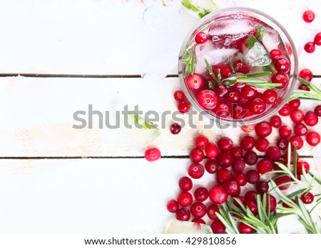Cranberry lemonade with rosemary and ice. Selective focus. Top view - stock photo