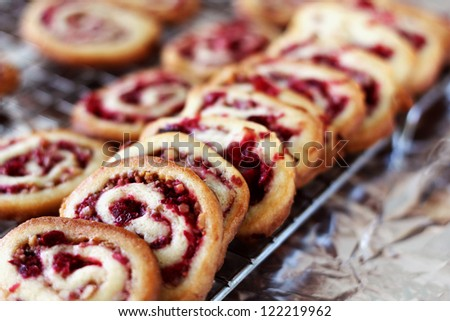 Cranberry nut swirl cookies cooling on rack.  (Selective focus) - stock photo