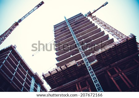Crane and building construction. big building construction - stock photo