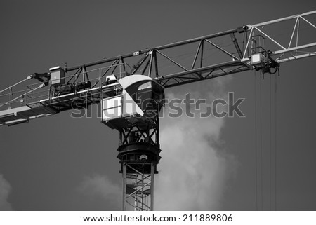 Crane and building construction construction site. black and white photography - stock photo
