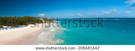 Crane Beach is one of the most beautiful beaches on the Caribbean island of Barbados. It is a tropical paradise with palms hanging over turquoise sea, panorama - stock photo