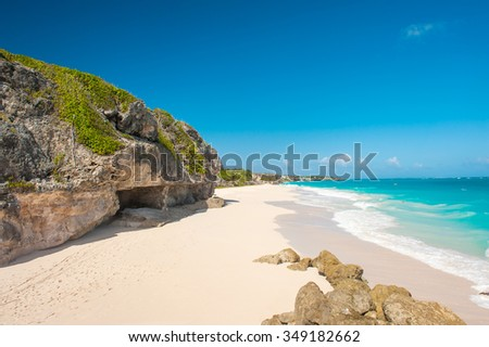 Crane Beach is one of the most beautiful beaches on the Caribbean island of Barbados. It is a tropical paradise with a white sand, turquoiuse sea and surrounding rocks - stock photo