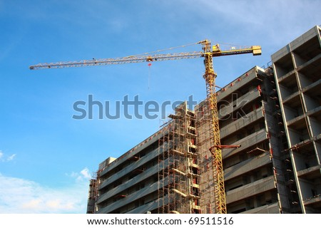 crane building construction with blue sky background - stock photo