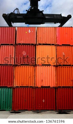Crane for lifting above a stack cargo container - stock photo