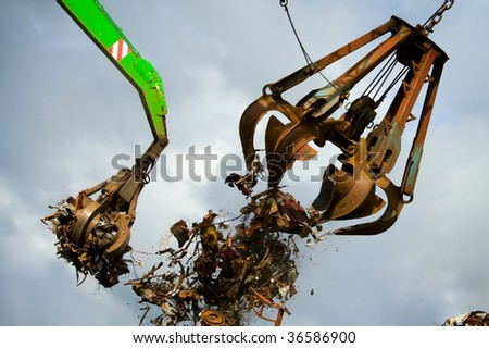 Crane Grabber Loading Recycling Steel - stock photo