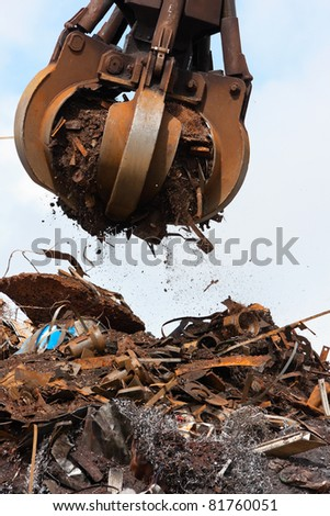 Crane grabber Loading Recycling Steel, Galway docks - stock photo