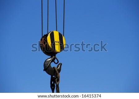 crane hook over blue sky - stock photo