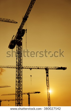 Crane in construction site - stock photo