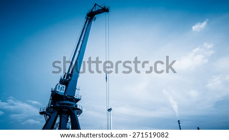 crane in the sky of harbor, china. - stock photo