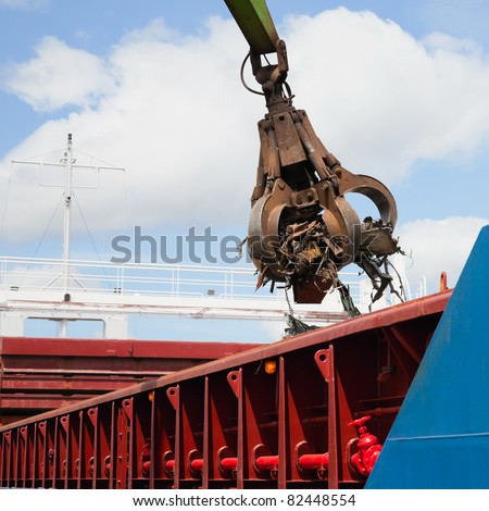 K Steel Galway with recycling steel scrap metal at a ship scrap metal at a ship crane ...