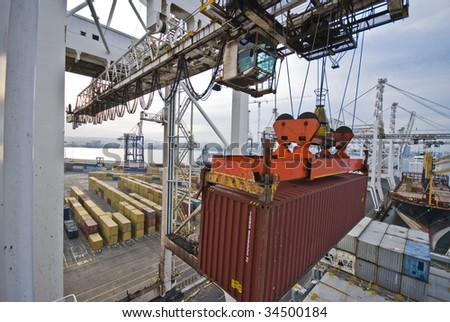 crane lowering a container - stock photo