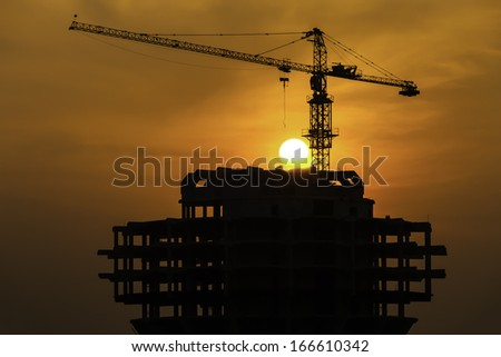 Crane on a construction site. - stock photo