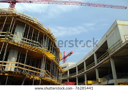 Crane on a construction site - stock photo