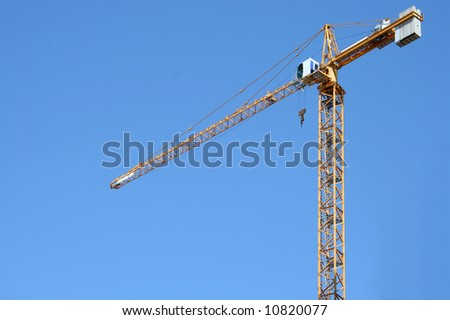 crane on clear blue background - stock photo