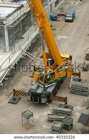 Crane on construction site. - stock photo