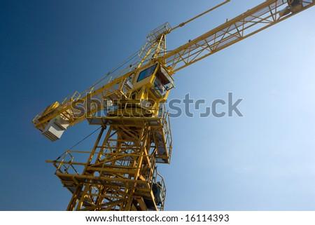Crane over deep blue sky, low shot - stock photo
