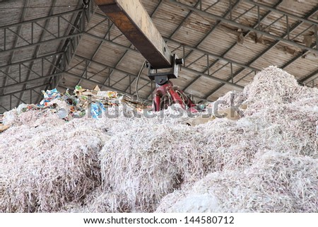 Crane picking up garbage for recycle - stock photo