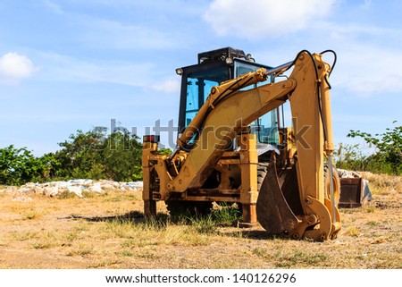 Crane truck parking in the field and sky background - stock photo