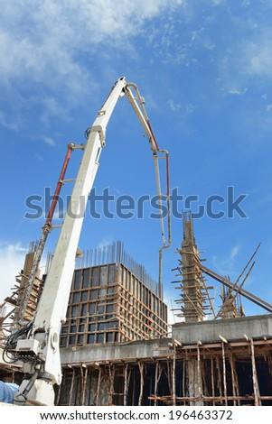 Crane unloading cement - stock photo