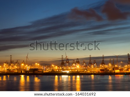 Cranes and containers in Hamburg - stock photo