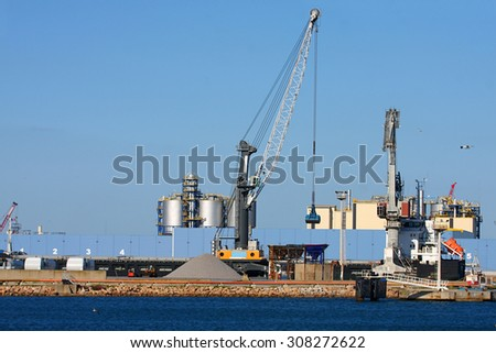 Cranes and lift trucks at a port in France